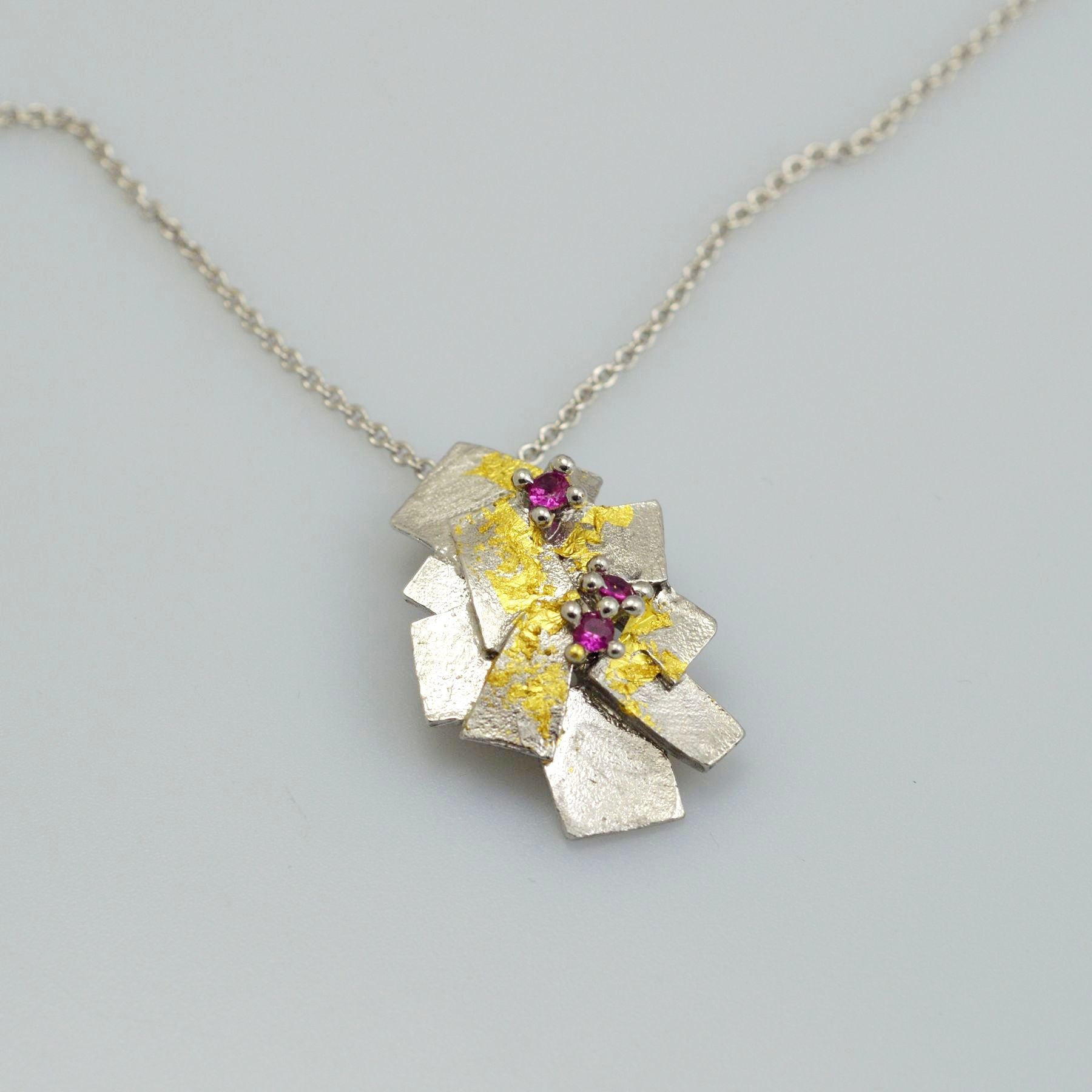 Silver pendant 925 rhodium plated with gold leaf 22K and synthetic stones