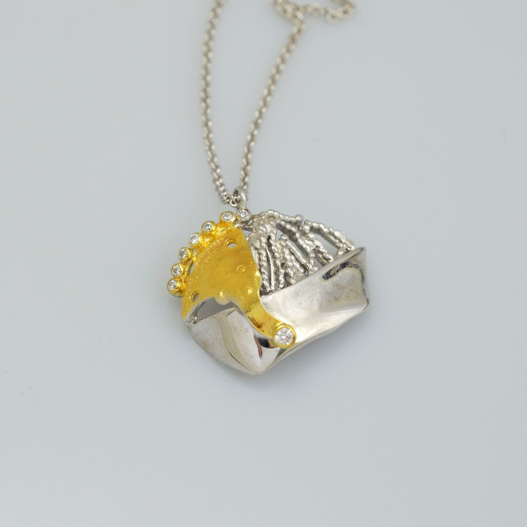 Silver pendant 925 rhodium and gold plated with synthetic stones