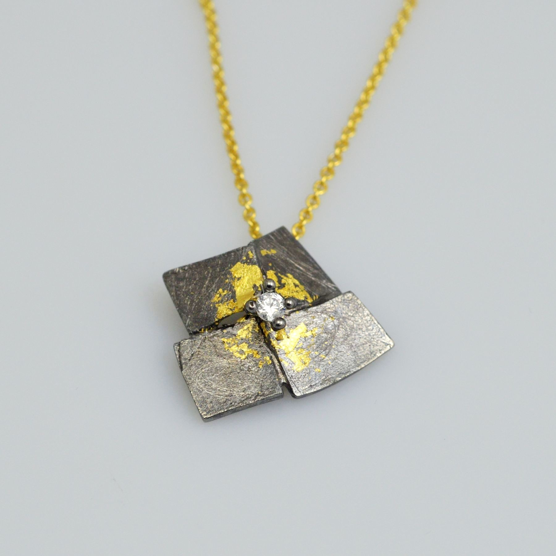 Silver pendant 925 black rhodium and gold plated with gold leaf 22K and synthetic stones