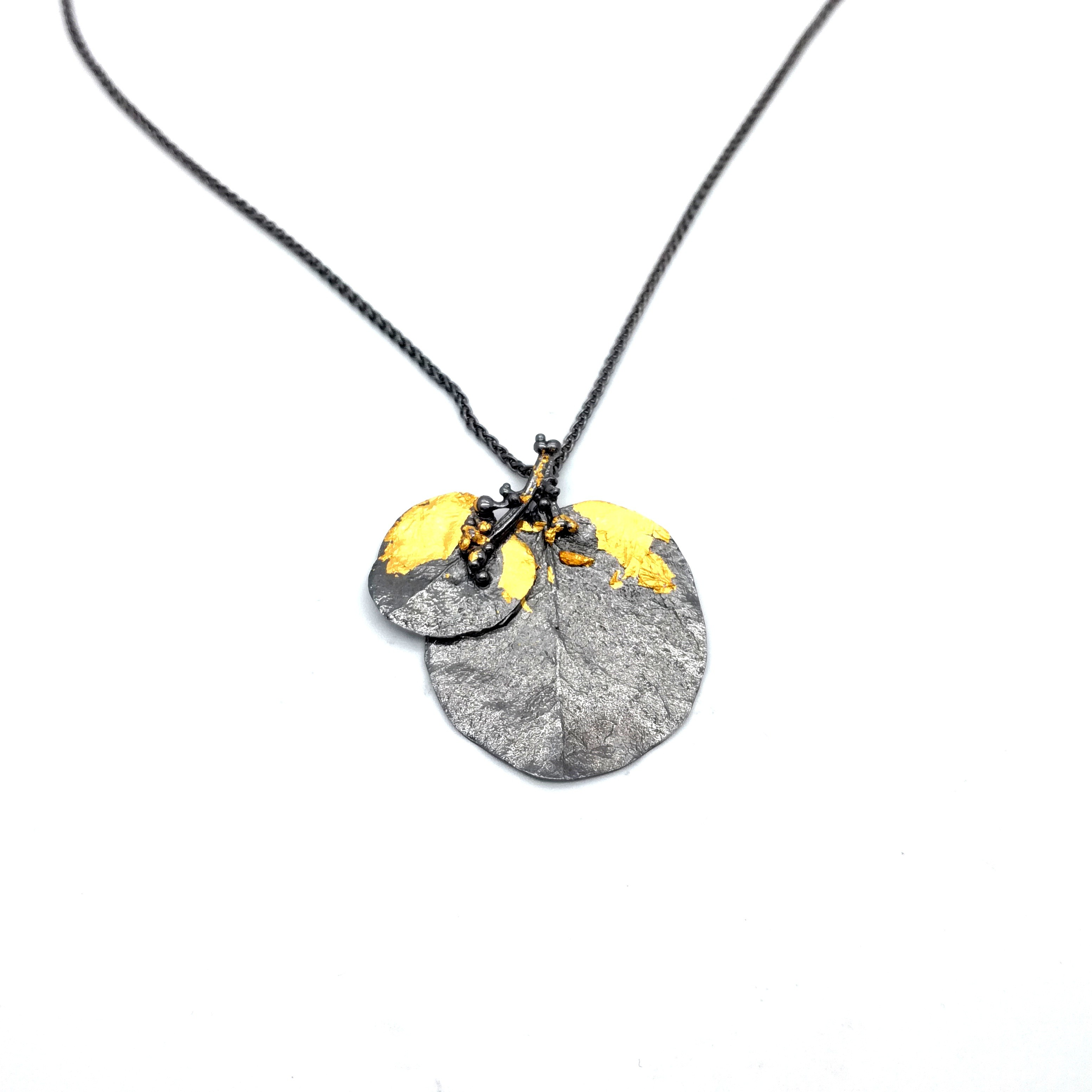 Silver pendant 925 black rhodium plated with gold leaf 22K